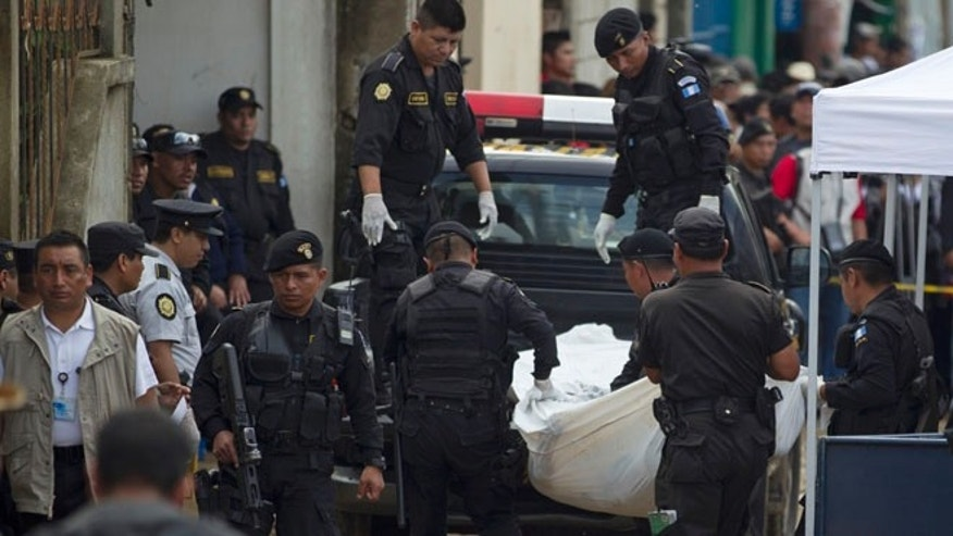 Sept. 8, 2013: Bodies are taken away by police after an attack in San Jose Nacahuil, on the outskirts of Guatemala City. Men firing from a car poured gunshots into three cantinas in this rural town, killing at least 10 people and injuring 19, local firefighters said Sunday.