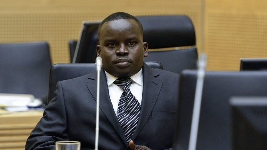 Joshua Arap Sang, Kenyan radio broadcaster looks on during a trial hearing at the International Criminal Court in the Hague, Netherlands, on May 14, 2013. Sang reported on post-election violence in 2007 that left hundreds dead, and now faces trial, accused of hate speech and organising killings.