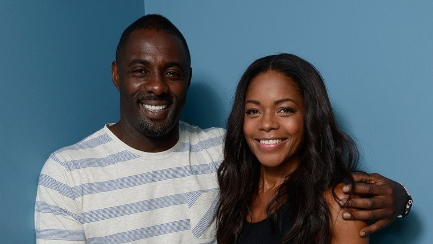 Actor Idris Elba and actress Naomie Harris of 'Mandela: Long Walk to Freedom' pose at the 2013 Toronto International Film Festival on September 8, 2013.