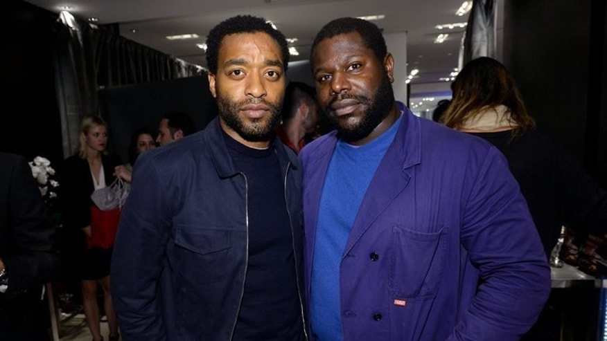"""Actor Chiwetel Ejiofor and director Steve McQueen at the Toronto International Film Festival on September 7, 2013. McQueen said he hoped his new movie """"12 Years a Slave"""" would open up fresh, frank discussion about the slave trade."""