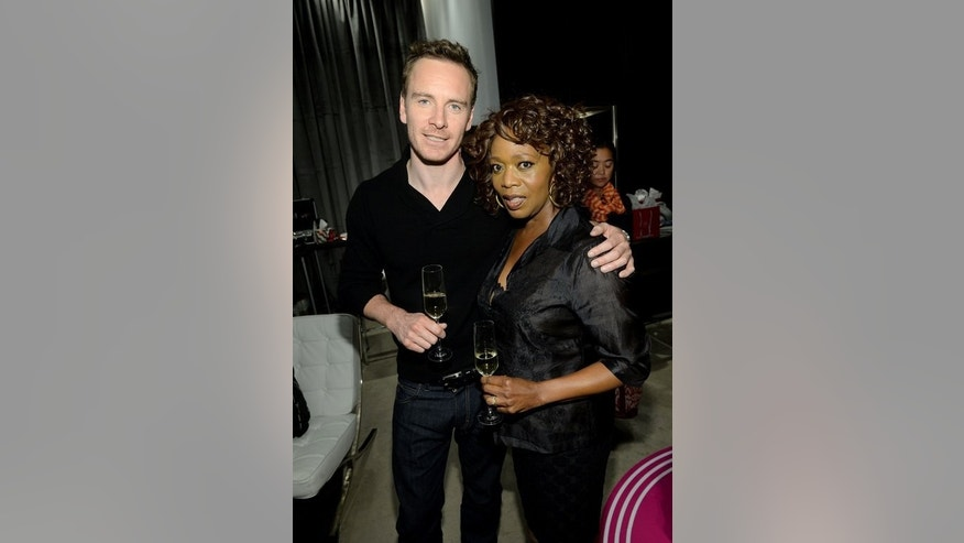 """Actors Michael Fassbender (L) and Alfre Woodard at theToronto International Film Festival on September 7, 2013. Fassbender, who plays cruel plantation owner Edwin Epps in """"12 Years a Slave"""", said: """"History writes it the way it is... It is what it is... It's real."""""""