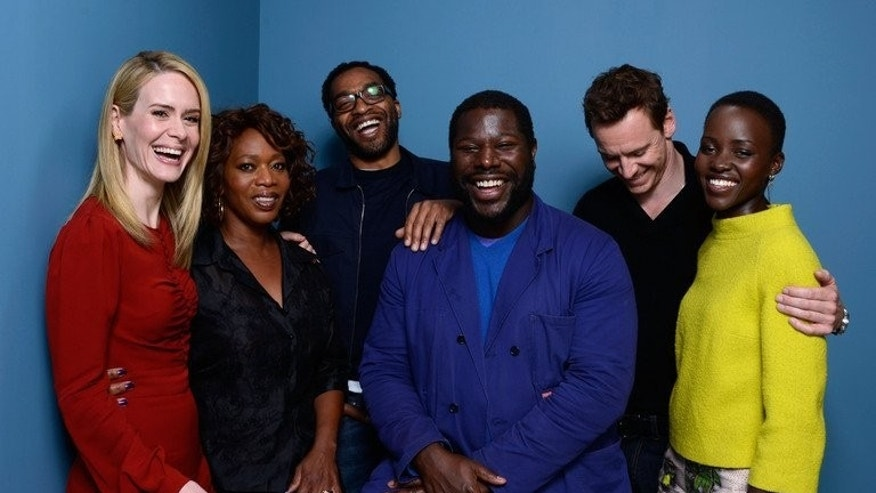 """Sarah Paulson, Alfre Woodard, Chiwetel Ejiofor, Steve McQueen, Michael Fassbender and Lupita Nyong'o in Toronto on September 7, 2013. """"12 Years a Slave"""" is based on a firsthand account of Solomon Northup, a free black man from upstate New York who was kidnapped and sold into slavery in 1841."""