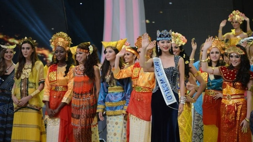Miss World 2013 contestants wave during opening ceremony in Nusa Dua, on the resort island of Bali on September 8, 2013. The pageant began amid tight security after days of Muslim hardline protests that forced the venue to be moved.