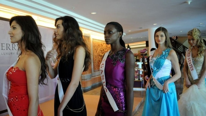 Miss World 2013 contestants prepare for their opening ceremony in Nusa Dua, on the resort island of Bali on September 8, 2013. The pageant began amid tight security after days of Muslim hardline protests that forced the venue to be moved.