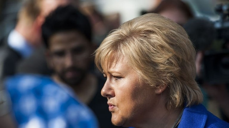 Norway's main opposition centre-right leader Erna Solberg talks to the press in front of the Parliament building in Oslo on September 7, 2013. Voting will open at 9:00 am (0700 GMT), one day after a survey in the daily Aftenposten showed 54.3 percent of voters backed the four centre-right parties. That would give them a comfortable majority of 95 of 169 seats in parliament.