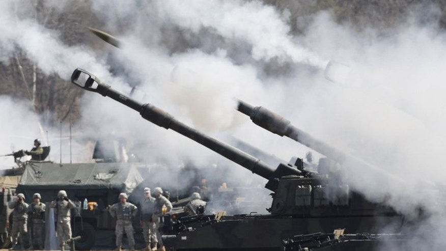 US Army howitzers at a live firing drill at the US army's Rodriguez range in Pocheon, on March 15, 2012. South Korea and the US have mapped out a joint operational plan outlining a response to the North's nuclear threats.