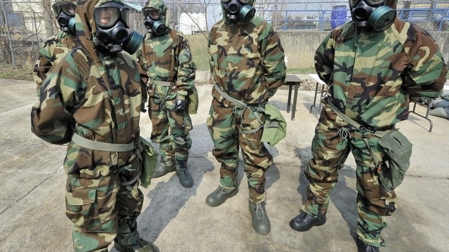 Soldiers of the US Army's 23rd Chemical Battalion in Uijeongbu, north of Seoul, on April 4, 2013. A joint plan drawn up between South Korea and the US in the event of provocation from North Korea encompasses political, military and diplomatic measures.