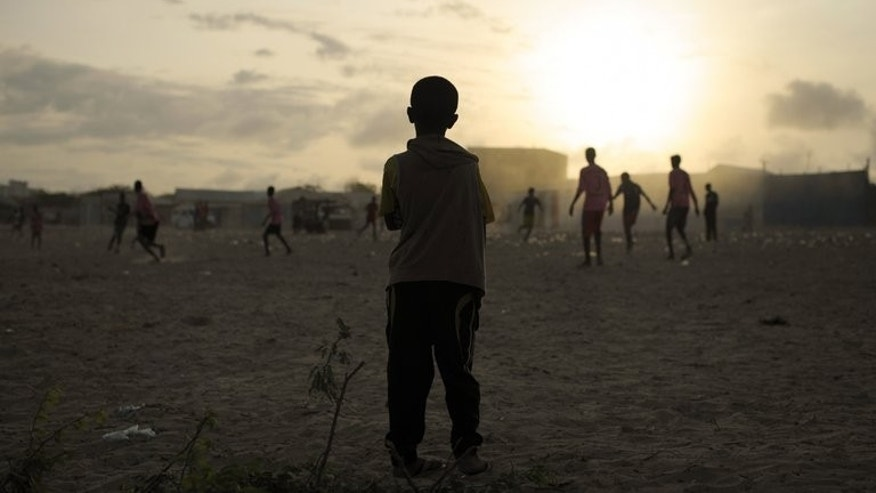 Children play football near a camp for Internally Displaced Persons in Mogadishu, Somalia on August 19, 2013. The Somali authorities are launching Sunday a campaign aimed at getting one million children in the war-torn nation into school, the United Nations' children's agency said.