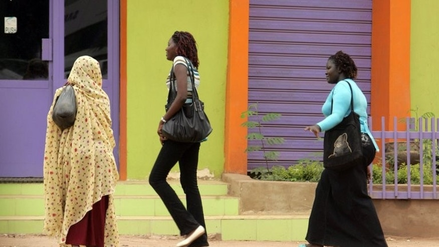 "Sudanese women walk in Khartoum street. A Sudanese woman says she is prepared to be flogged to defend the right to leave her hair uncovered in defiance of a ""Taliban""-like law."