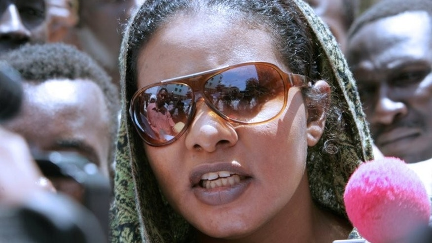 "Sudanese journalist Lubna Ahmed al-Hussein talks to the media outside a Khartoum court after a hearing in her 'trousers' case, on September 7, 2009. A Sudanese woman says she is prepared to be flogged to defend the right to leave her hair uncovered in defiance of a ""Taliban""-like law."