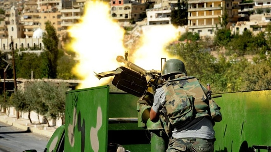 Sept. 7, 2013: In this photo released by the Syrian official news agency SANA, a Syrian military solider fires a heavy machine gun during clashes with rebels in Maaloula village, northeast of the capital Damascus, Syria. Rebels including Al Qaeda-linked fighters gained control of Maaloula, Syrian activists said Sunday. Government media provided a dramatically different account of the battle suggesting regime forces were winning.