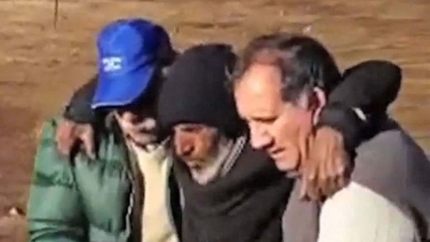 Uruguayan Raul Gomez Cincunegui (C) is rescued in San Juan, Argentina on September 8, 2013, in this video screen grab. The 58-year-old Uruguayan who vanished in the freezing Andes for four months turned from valiant survivor to crime suspect after authorities revealed he was fleeing pedophilia charges.