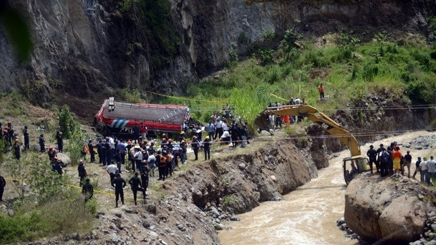 Rescuers work at the site of a bus accident on September 9, 2013 in the municipality of San Martin Jilotepeque, Guatemala. The bus plunged off a steep cliff killing at least 43 people -- including newborn babies -- and injuring 40 others.