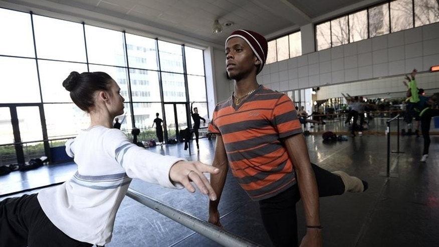 Dancers practice at the South African Mzansi Ballet Academy (SAMB) on July 30, 2013 in Johannesburg. SAMB, the city's professional ballet company aims to uplift young people through dance and shed its elitist image.
