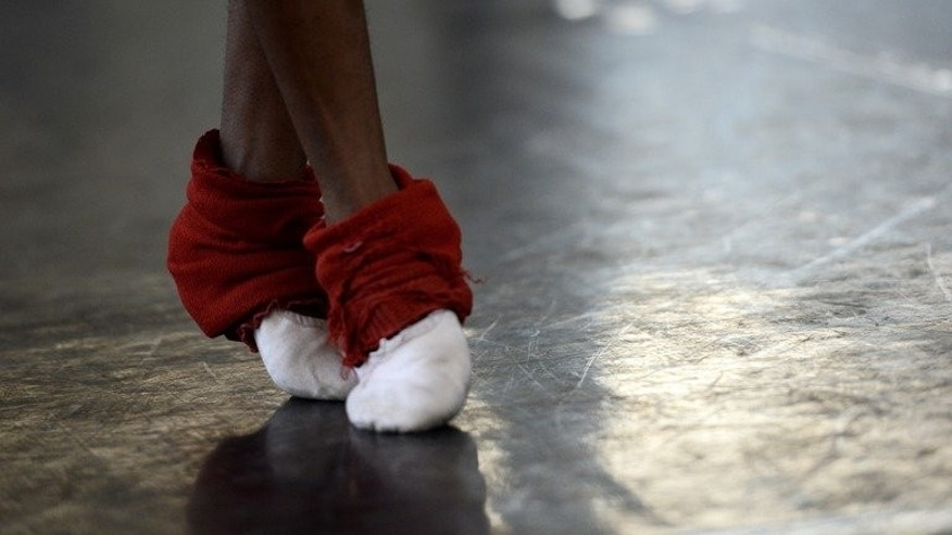 "Close up of a dancers feet during practice at the South African Mzansi Ballet Academy on July 30, 2013 in Johannesburg. The word ""Mzansi"" means south in the Zulu language and is commonly used to refer to South Africa."