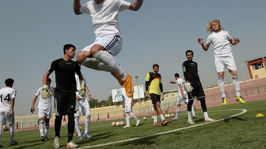 Afghan footballers participate in a training session at the Kabul stadium on September 2, 2013. The Afghan Premier League is split into eight teams covering the whole country to give all Afghans a side to support, and it hopes to promote better ethnic ties after decades of warfare and conflict.