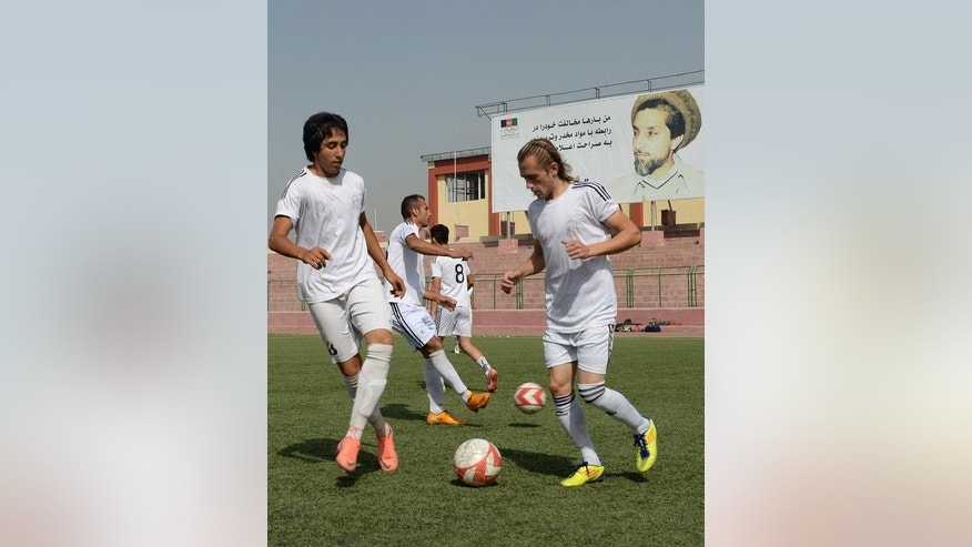 Afghan footballers participate in a training session at the Kabul stadium on September 2, 2013. The Afghan Premier League, sponsored by mobile phone company Roshan, has attracted crowds of a few thousand to each match.
