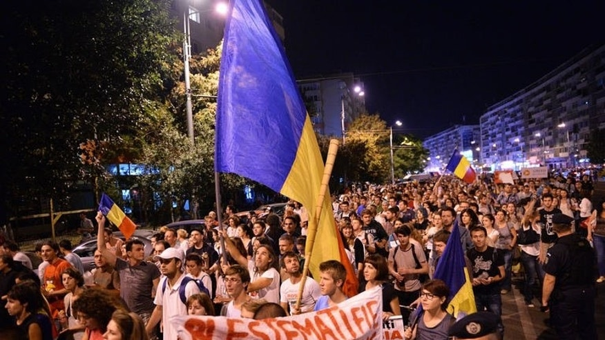 Protesters march during the eighth day of demonstrations in Bucharest against a Canadian gold mine project using cyanide, on September 8, 2013.