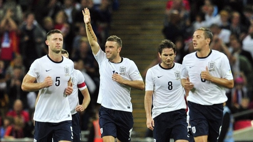 England's Rickie Lambert (2nd L) celebrates after scoring during the World Cup qualifier against Moldova in London on September 6, 2013. England can take a significant step towards World Cup qualification when they face Ukraine.