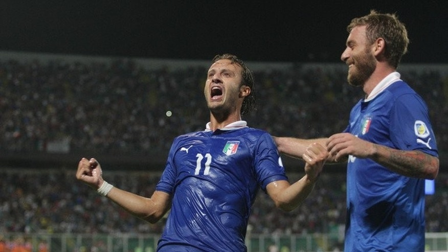 Italy's Alberto Gilardino celebrates after scoring during the World Cup qualifier against Bulgaria on September 6, 2013. Italy, who stretched their lead at the top of their group to seven points with a 1-0 win over Bulgaria, can secure their place in Brazil with a win over the third-placed Czechs.