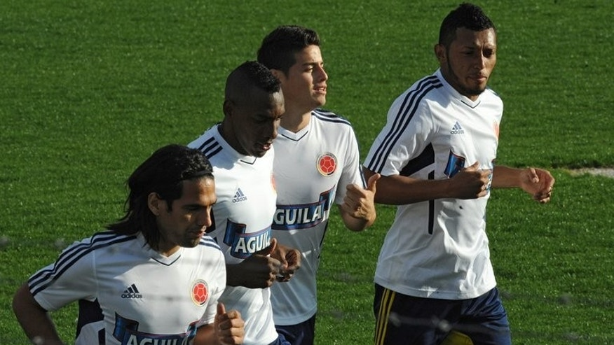 Colombia's (L-R) Radamel Falcao, Luis Amaranto Perea, James Rodriguez and Carlos Valdes trains in Montevideo on September 8, 2013. Colombia have moved level on points at the top will be ready to capitalise on any slip-up when they go to Montevideo for the clash against Uruguay.