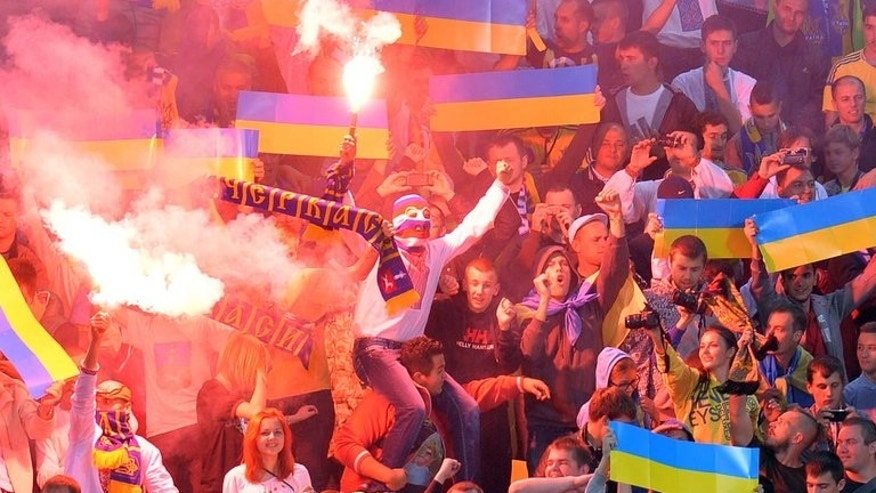 Ukraine supporters cheer during the 2014 World Cup qualifying football match against San Marino in Lviv on September 6, 2013. Three English football fans were hospitalised and 10 more received minor injuries in a clash with Ukrainian youngsters in central Kiev before Tuesday's crucial Ukraine-England 2014 World Cup qualifying match, police said.