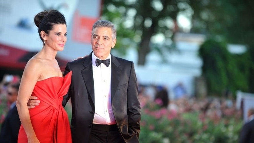 "US actor George Clooney and US actress Sandra Bullock arrive for the opening ceremony of the 70th Venice Film Festival and the screening of the movie ""Gravity"" presented out of competition, on August 28, 2013."