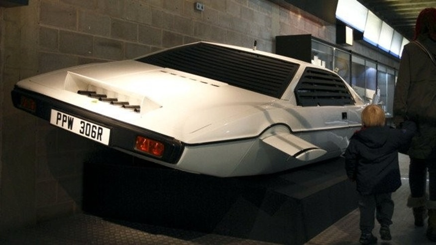 "A family walks past the Lotus Esprit underwater car from the James Bond film ""The Spy Who Loved Me"" at the Beaulieu National Motor Museum on January 15, 2012."