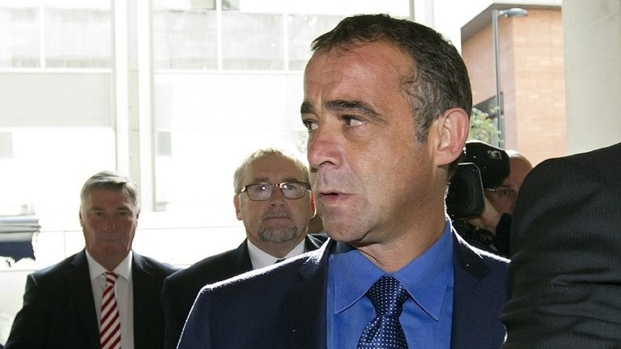 Michael Turner, who uses the stage name Michael Le Vell, arrives at Manchester Crown Court, on September 9, 2013. The actor, best known for his role as mechanic Kevin Webster in the soap opera Coronation Street, appeared in court to face a total of 12 child sex offences.