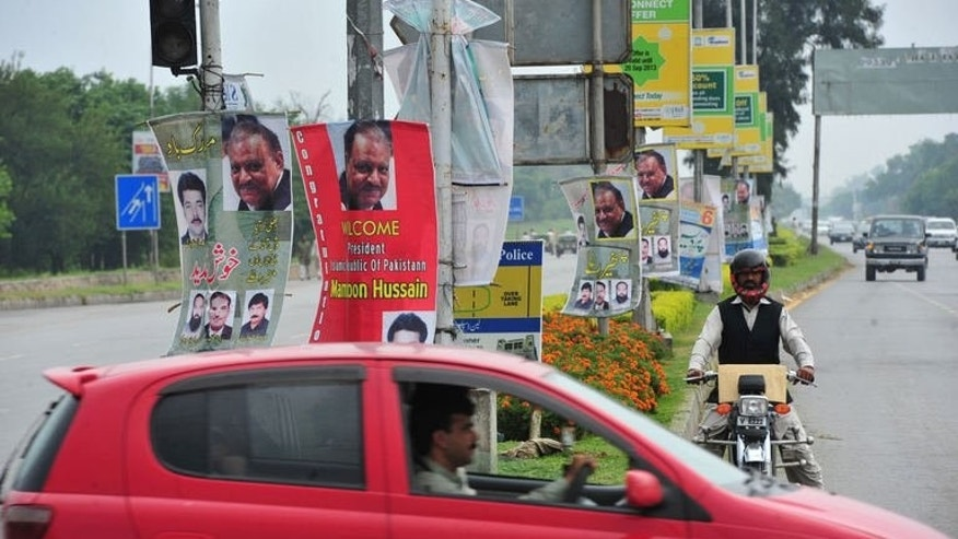 Roadside banners welcoming and congratulating incoming Pakistani President Mamnoon Hussain are pictured in Islamabad on September 9, 2013.
