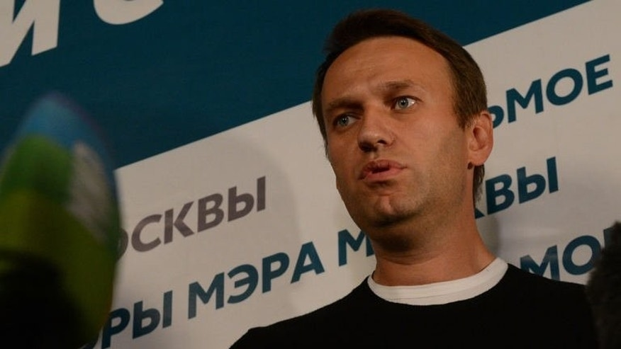Opposition candidate in Moscow mayoral race, Alexei Navalny, speaks to the media at his campaign headquarters in Moscow, on September 8, 2013. Navalny on Monday warned of protests after narrowly failing to push Moscow's pro-Kremlin mayor into a run-off in tight elections he claimed were marred by falsifications.