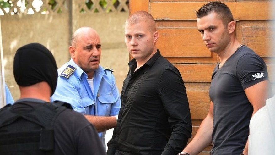 Eugen Darie and Radu Dogaru, two of the six suspects in the Dutch art heist trial, pictured in Bucharest on August 13, 2013. Dogaru and most of his accomplices have admitted stealing the paintings.