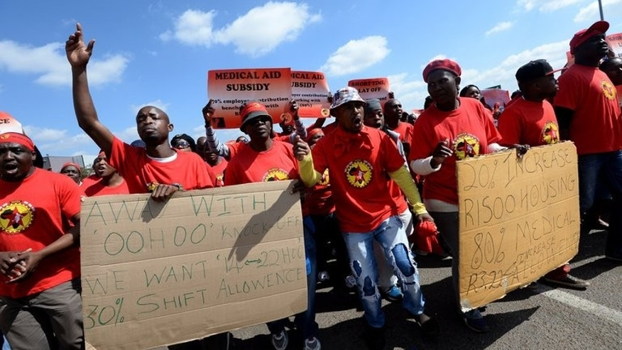 Workers of the National Union of Metalworkers of South Africa (Numsa), on strike in Pretoria on August 20, 2013. A fresh strike by South African petrol station attendants got off to a slow start despite their union calling for them to join a wave of stoppages over wages sweeping the country.