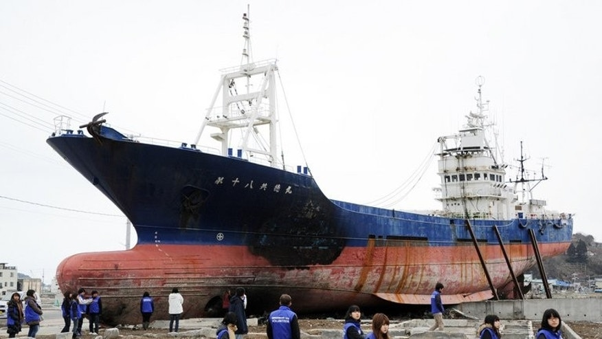 The 330-ton fishing vessel Kyotoku Maru No. 18., pictured on March 8, 2012. On Monday workers started to dismantle the ship, which was swept half a kilometre inland during the 2011 tsunami.