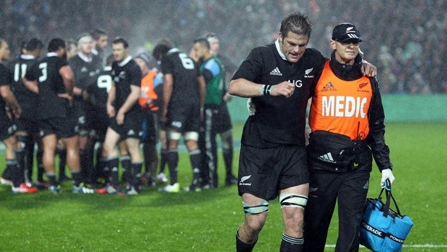 "New Zealand's Richie McCaw is helped off the field during the Rugby Championship match against South Africa on September 7, 2013. The Springboks landed in Auckland Monday for ""the ultimate challenge"" against the All Blacks next weekend, claiming they remain the underdogs despite New Zealand losing McCaw."