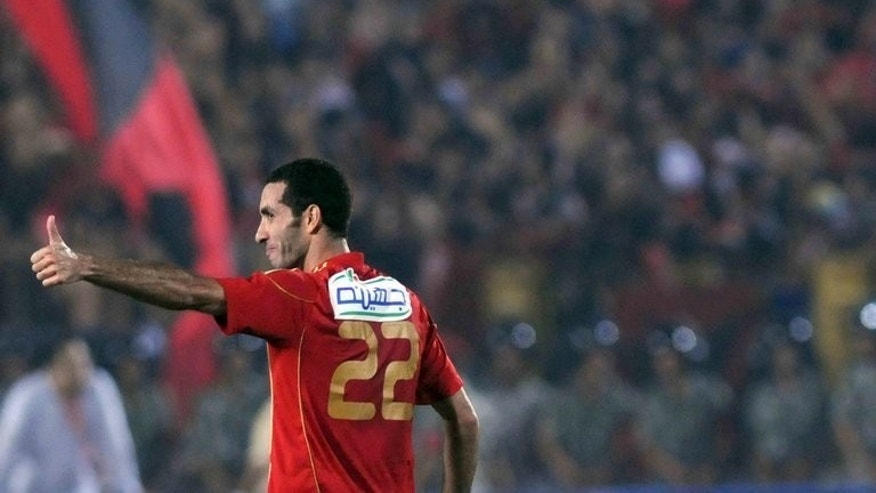 Mohamed Abou Trika scores in Cairo on September 16, 2011. Abou Trika celebrated his 100th cap by scoring one goal and creating three in a 4-2 World Cup qualifying win over 10-man Guinea