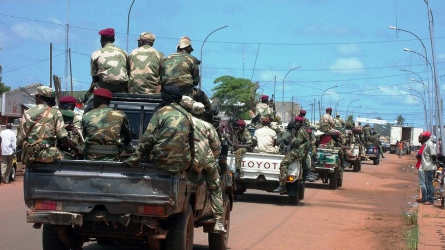 Central African troops drive through the streets of Bangui, on September 5, 2013. Armed supporters of ousted president Francois Bozize have seized control of villages close to Bossangoa, where fighting has killed at least 60 people, military sources tell AFP.