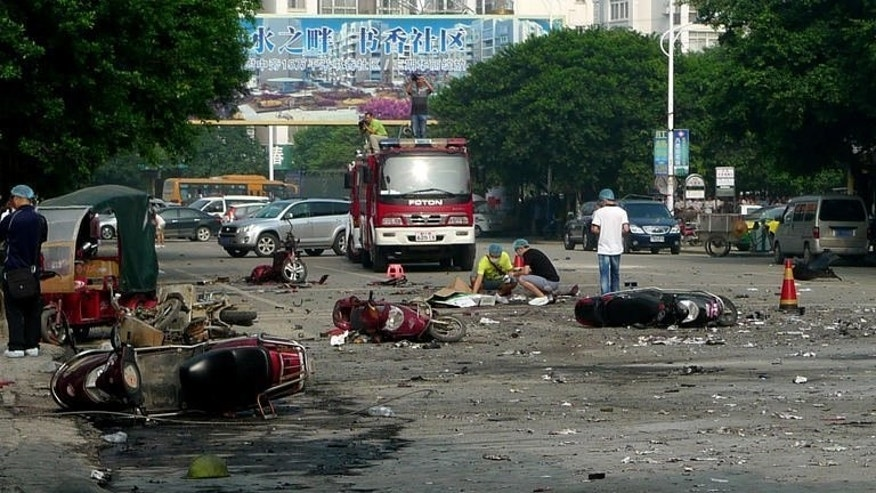 Damaged motorbikes and debris lie on the ground after an explosion outside a primary school in Guilin, southwest China's Guangxi province on September 9, 2013, which killed two people and injured at least 44 others, 26 of them schoolchildren, state-run media and a local official said.