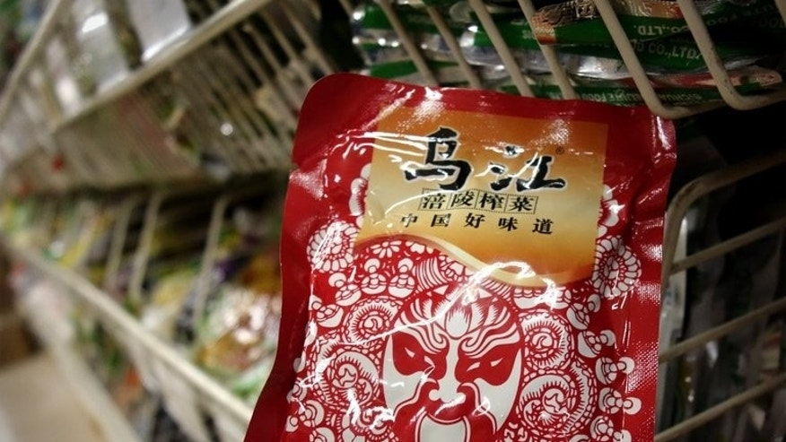 Fuling Zhacai -- pickled root vegetable -- is seen on sale at a supermarket in Beijing on August 14, 2013. Shares in a Chinese food company became one of the market's hottest stocks on Tuesday after Xi Jinping gave its spicy pickles the presidential stamp of approval.