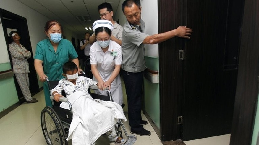 Medics care for six-year-old Guo Bin, known as Bin-Bin, who was blinded when his eyes were gouged out, in a hospital in Taiyuan, north China's Shanxi province on September 4, 2013. A six-year-old Chinese boy who had his eyes gouged out while playing outside underwent surgery Tuesday as doctors began fitting him with realistic artificial eyeballs that move.