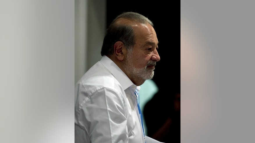 The world's richest person, Mexican tycoon Carlos Slim, pictured in Mexico City on March 17, 2013. Slim topped the rankings with an estimated fortune of $73 billion.