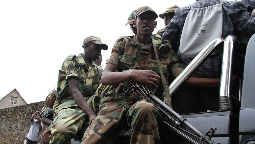 M23 rebels patrol the streets of Bunagana, on January 3, 2013. The Democratic Republic of Congo and M23 rebels have restarted peace talks following an ultimatum set by regional leaders, according to the chief mediator.