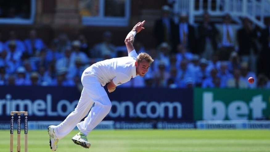 England's Stuart Broad bowls during the second day of the second Ashes cricket Test match between England and Australia at Lord's cricket ground in north London, on July 19, 2013. Former England captain David Gower believes Broad can win over fans in Australia during the upcoming Ashes series if he follows the lead of David Warner.