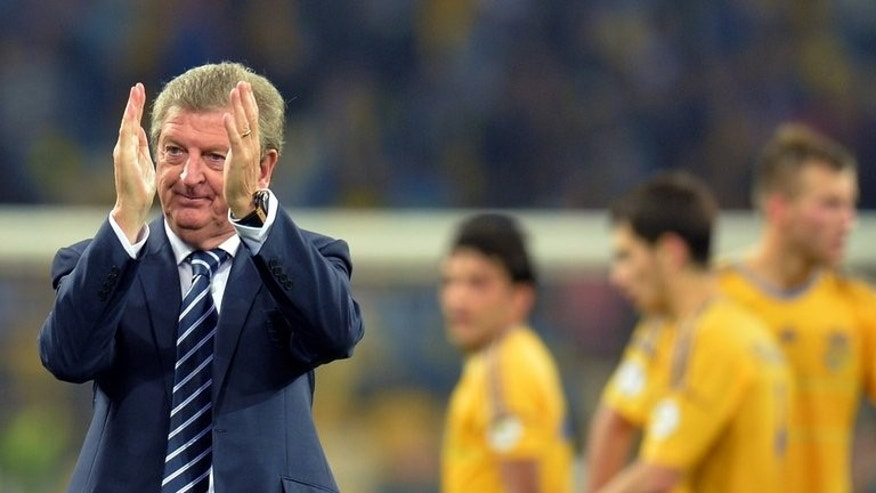 England coach Roy Hodgson applauds on September 10, 2013 after a 2014 FIFA World Cup, group H qualifying football match against Ukraine in Kiev. Hodgson defended his side against criticism from former national team captain Gary Lineker after their lacklustre 0-0 draw