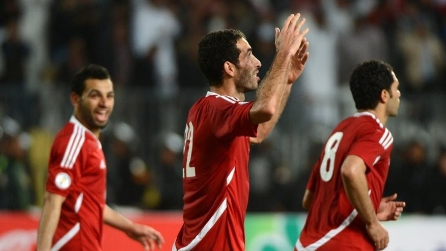 Mohammed Aboutrika (centre) celebrates a goal against Zimbabwe in a World Cup qualifier in Alexandria on March 26. On Tuesday, Egypt meets Guinea in the final round of qualifiers for the World Cup to be held in Brazil next year, and the Pharaohs have a chance of making it to the tournament for the first time since 1990.
