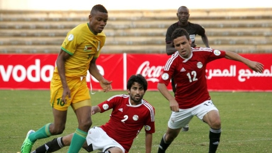 Kenawi Ahmed (right) breaks away from Zimbabwe's Ovidy Karuru in Harare on June 9. Today it would take much more than a football tournament to band Egyptians together after a deadly crackdown on Islamists that followed the military's removal of president Mohamed Morsi on July 3.