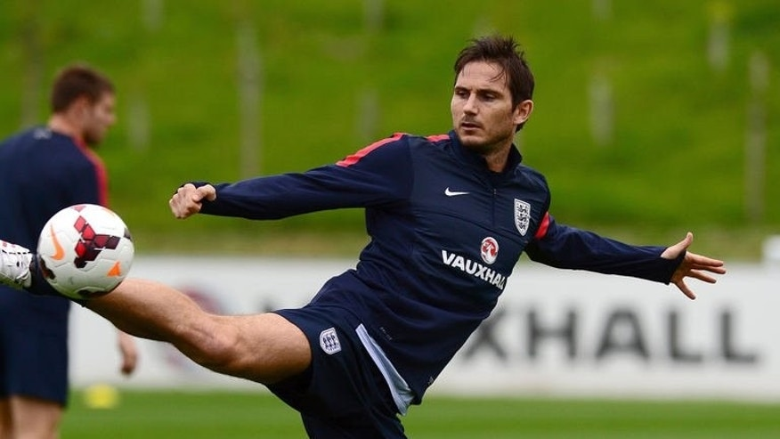 England midfielder Frank Lampard kicks the ball during a training session in Burton-on-Trent, central England, on September 3, 2013.