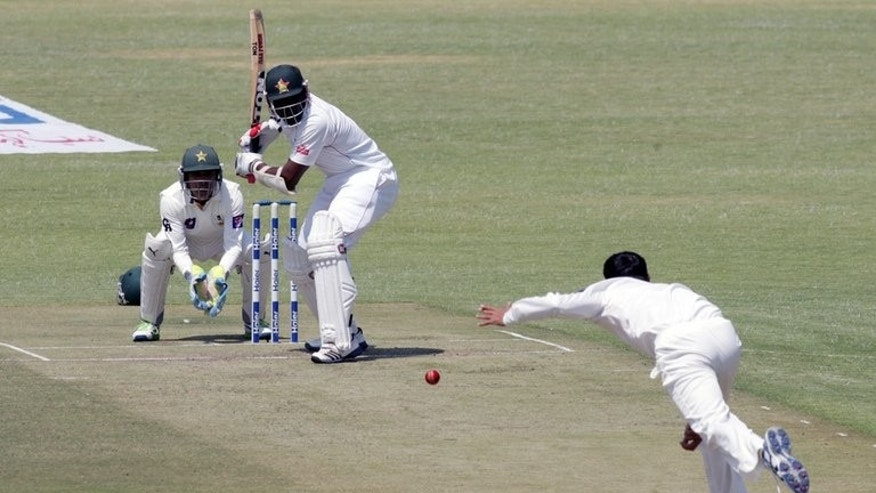 Hamilton Masakadza faces a delivery from Younis Khan in the second at the Harare Sports Club on Tuesday. Zimbabwe were 65 for two after 27 overs against Pakistan at lunch Tuesday as they sought to level the series in the second and final Test.