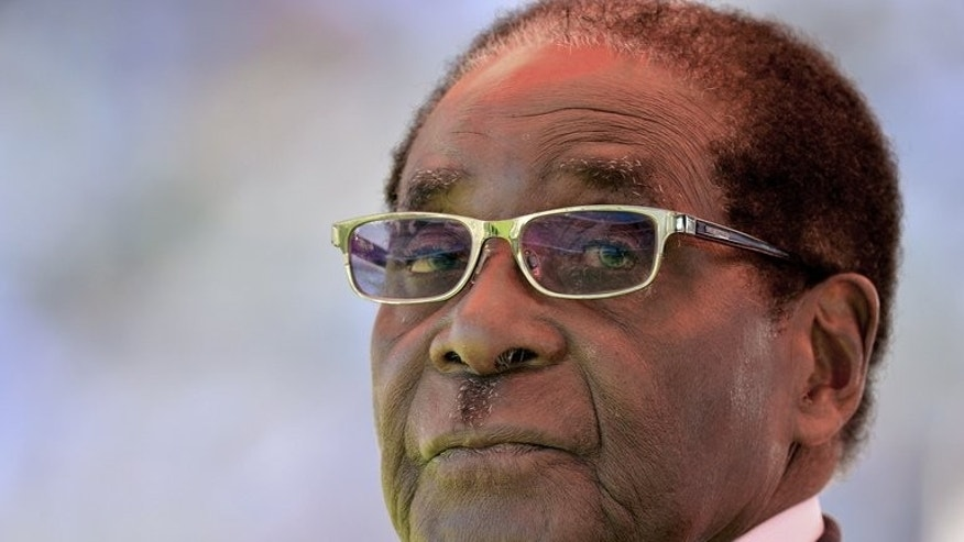 Zimbabwean President Robert Mugabe looks on during his inauguration and swearing-in ceremony on August 22, 2013 in Harare.
