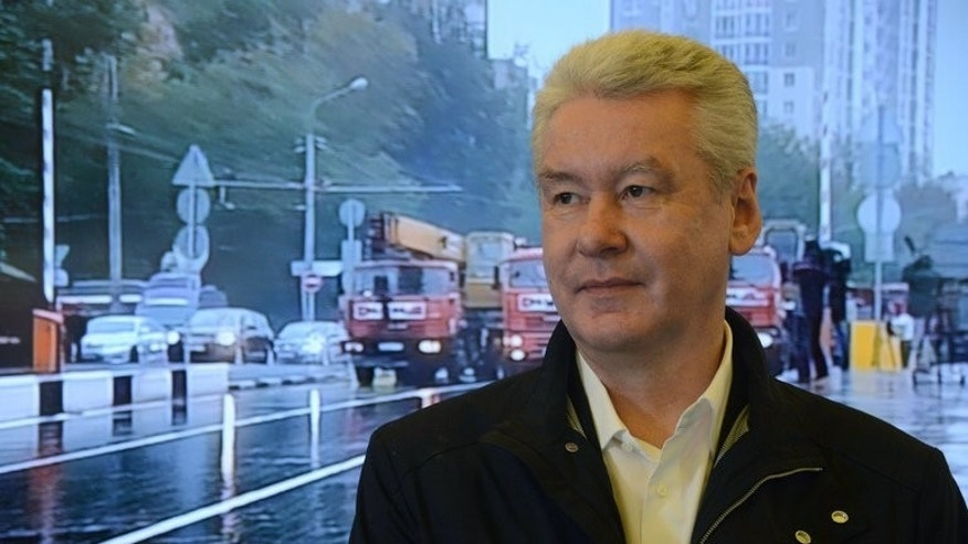 Moscow mayor Sergei Sobyanin stands near a huge screen displaying a view of a street in Moscow, on September 6, 2013. Russian opposition leader Alexei Navalny vowed Tuesday to make an ally of Russian President Vladimir Putin pay dearly for his Moscow poll win, saying he was preparing evidence to contest the vote results.